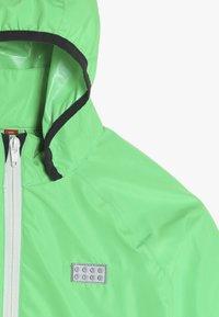 LEGO Wear - JOSHUA JACKET PACKABLE - Hardshellová bunda - green - 5