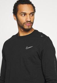 Nike Sportswear - Long sleeved top - black - 2