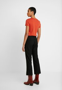 Selected Femme - SLFADA CROPPED FLARED PANT NOOS - Trousers - black - 2