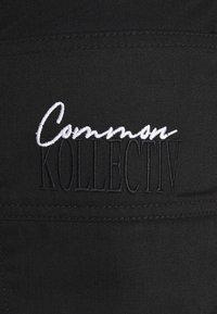 Common Kollectiv - WORKWEAR UNISEX - Shorts - black - 2