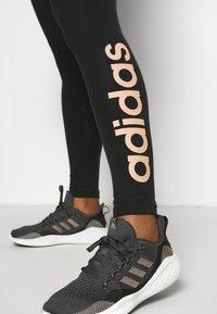 adidas Performance - LOUNGEWEAR ESSENTIALS HIGH-WAISTED LOGO LEGGINGS - Tights - black/ambient blush - 4