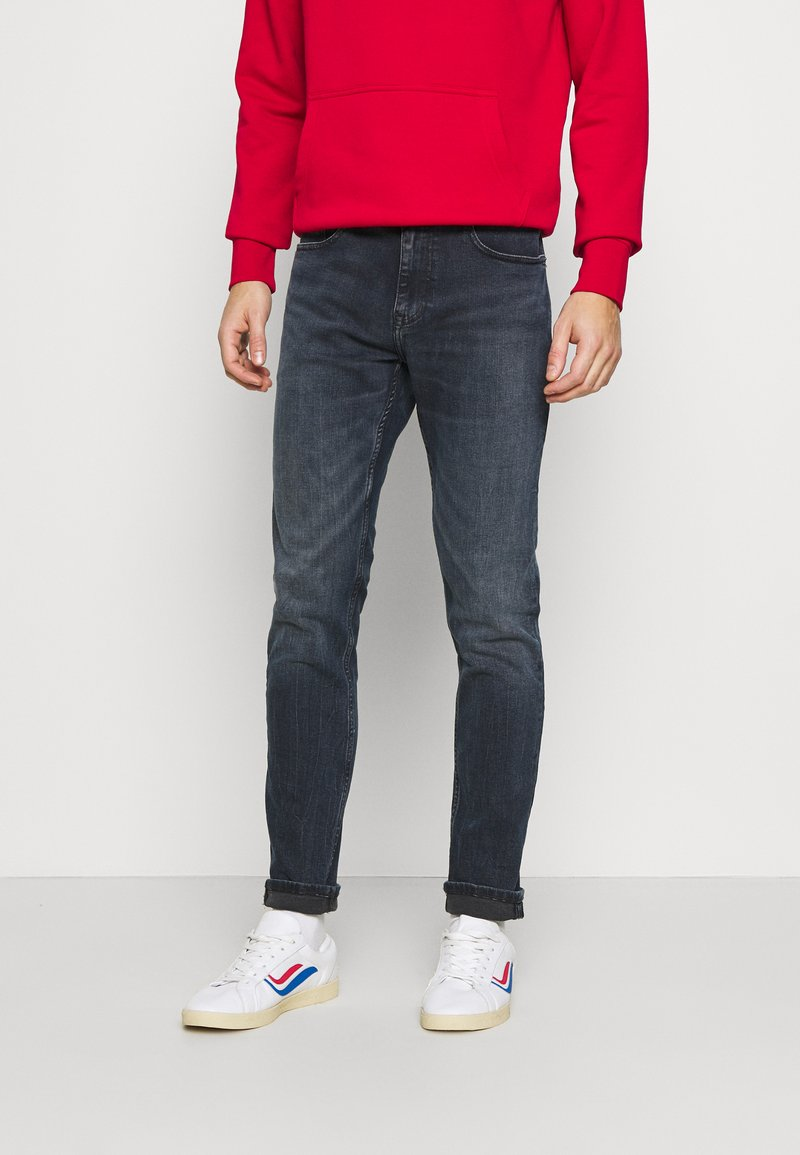 Tommy Jeans - AUSTIN - Jeans Tapered Fit - midnight dark blue