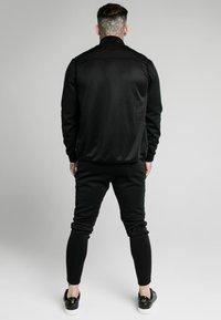 SIKSILK - Waistcoat - black & fluro white - 2