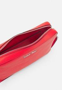Calvin Klein - CAMERA BAG WAVE SAFFIANO - Across body bag - red - 2