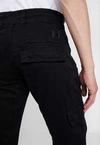 Alpha Industries - Cargo trousers - black - 3