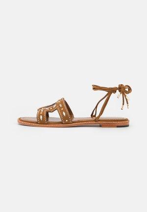 Sandaalit nilkkaremmillä - caramel