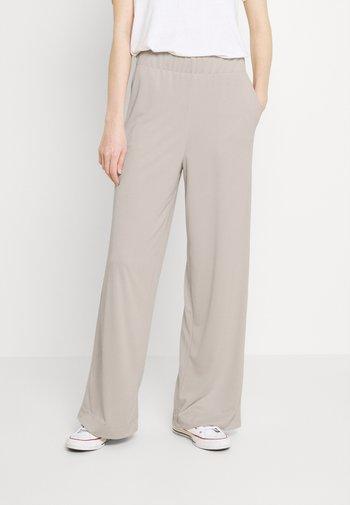 CLEO TROUSERS - Trousers - beige dusty light