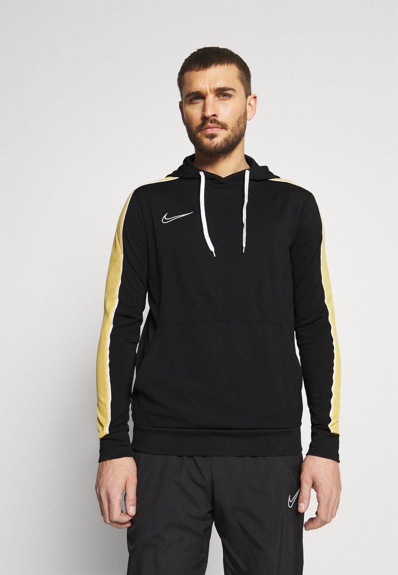 Nike Performance - DRY HOODIE - Langærmede T-shirts - black/saturn gold/white