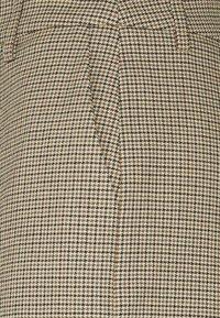Gestuz - GRITA PANTS - Trousers - sand/black - 5