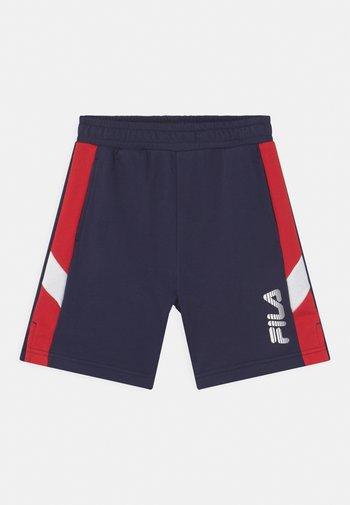 MIO - Tracksuit bottoms - black iris/true red/bright white