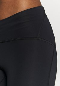 Under Armour - FLY FAST - Leggings - black
