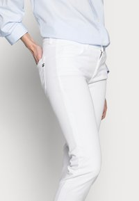 Marc O'Polo - Slim fit jeans - white - 3