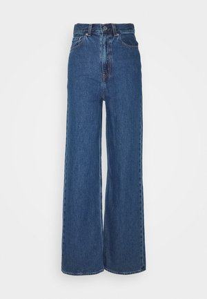 HIGH LOOSE - Flared Jeans - blue denim