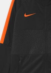 Nike Performance - AS ROM UNISEX - Klubové oblečení - black/safety orange - 3