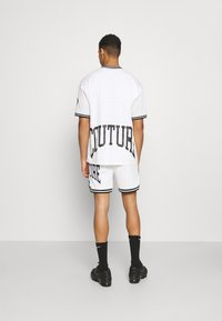 The Couture Club - VARSITY BADGED MESH DROP CROTCH SHORTS - Shorts - off white - 2