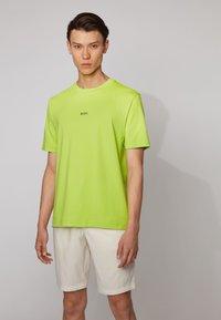 BOSS - TCHUP - Basic T-shirt - yellow - 0