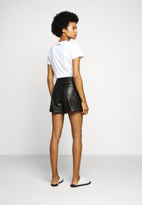 KARL LAGERFELD - Leather trousers - black - 2