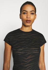 Calvin Klein Jeans - BURN OUT ZEBRA LOGO - Print T-shirt - black - 6