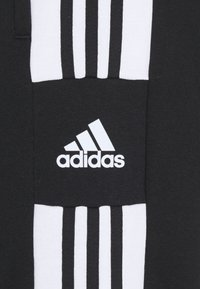 adidas Performance - SQUAD - Tracksuit bottoms - black - 5