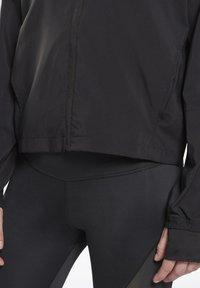 Reebok - RUNNING ESSENTIALS - Training jacket - black - 4