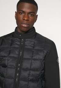 Calvin Klein Jeans - MOTO JACKET - Light jacket - black - 3
