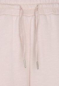 Sweaty Betty - ESSENTIALS - Tracksuit bottoms - antique pink - 6