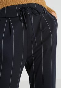 ONLY - ONLPOPTRASH TEMPO STRIPE PANT  - Trousers - night sky/white - 3