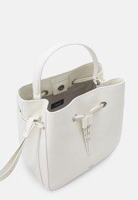 HUGO - VICTORIA DRAWSTRING - Across body bag - white - 3