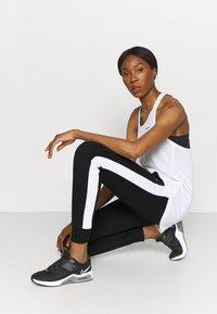 Fila - LAKI PANTS - Spodnie treningowe - black/bright white - 4