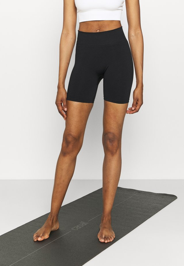 SEAMLESS SHORTS               - Leggings - black