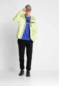 Helly Hansen - BELFAST PACKABLE JACKET - Impermeable - sunny lime - 1