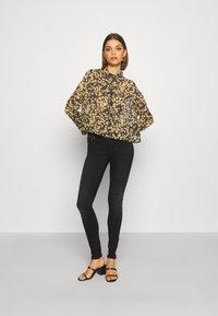 Tommy Jeans - GATHER DETAIL BLOUSE - Button-down blouse - black/yellow - 1