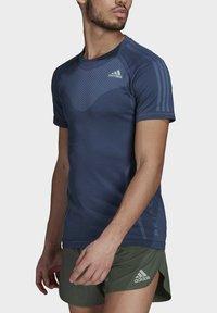 adidas Performance - T-shirts med print - blue - 3