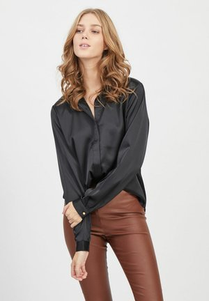 LOOSE FIT - Button-down blouse - black