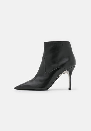 CODE  - High heeled ankle boots - nero