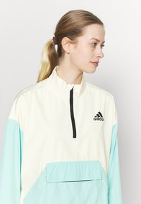 adidas Performance - Back-to-School W.R ANORK URBAN WIND.RDY OUTDOOR RELAXED JACKET - Windbreaker - cream white/clear mint - 3