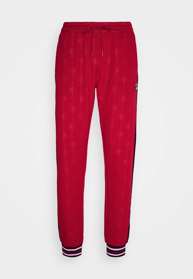 HANK TRACK PANT - Tracksuit bottoms - true red/black iris