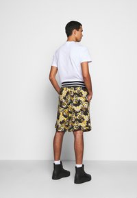 Versace Jeans Couture - PRINT NEW LOGO - Pantaloni sportivi - nero - 2