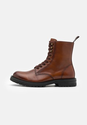 KOMMBAT - Lace-up ankle boots - cognac