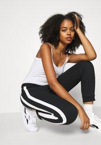 Even&Odd - Spodnie treningowe - black/white - 5