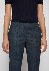 BOSS - TILUNA - Trousers - patterned - 3