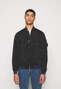 C.P. Company - OUTERWEAR SHORT JACKET - Summer jacket - black - 0