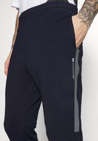 Jack & Jones - JCORUNNING PANTS  - Tracksuit bottoms - navy blazer - 4