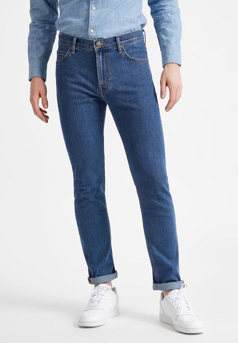 Lee - RIDER - Straight leg jeans - mid stone