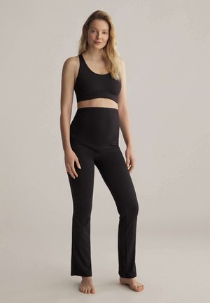 COMFORT FLARE MATERNITY  - Tracksuit bottoms - black