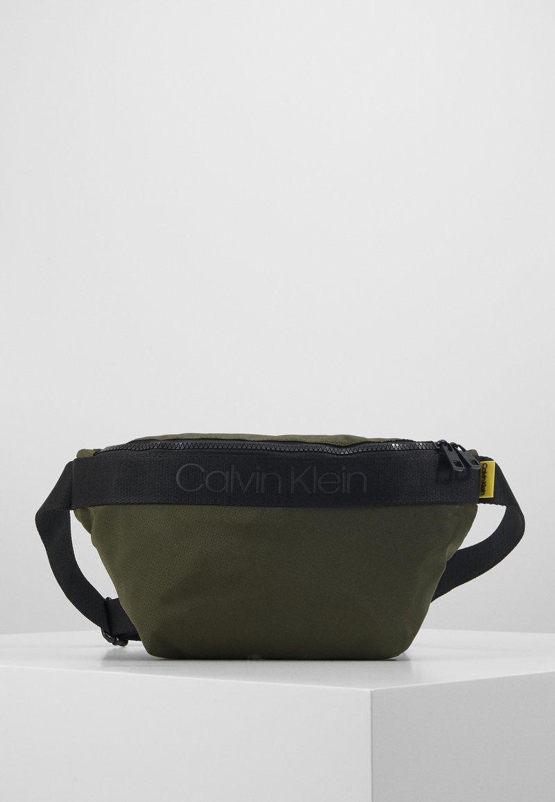 Calvin Klein - NASTRO LOGO WAISTBAG - Saszetka nerka - green