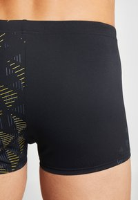 Arena - ONE TUNNEL VISION - Swimming trunks - black/yellow - 1