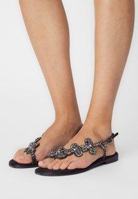 KHARISMA - T-bar sandals - nero - 0