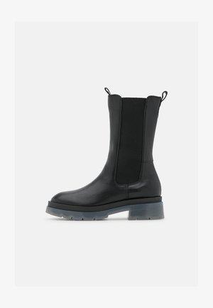 FILIPPA  - Platform boots - black/translucent
