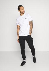 YOURTURN - UNISEX - Pantalon de survêtement - black - 1